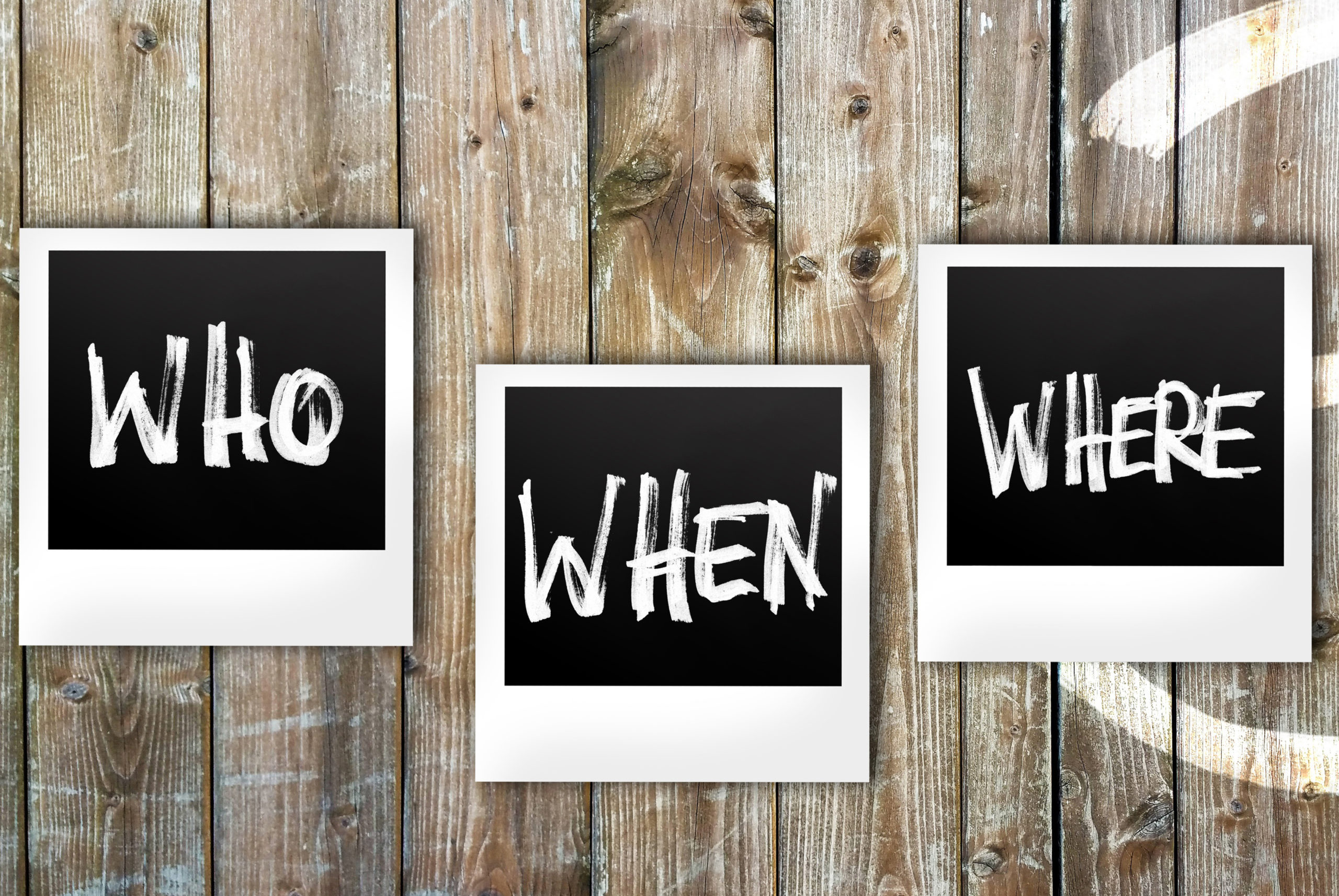"""""""Who, When, Where"""" signs on a wooden wall"""