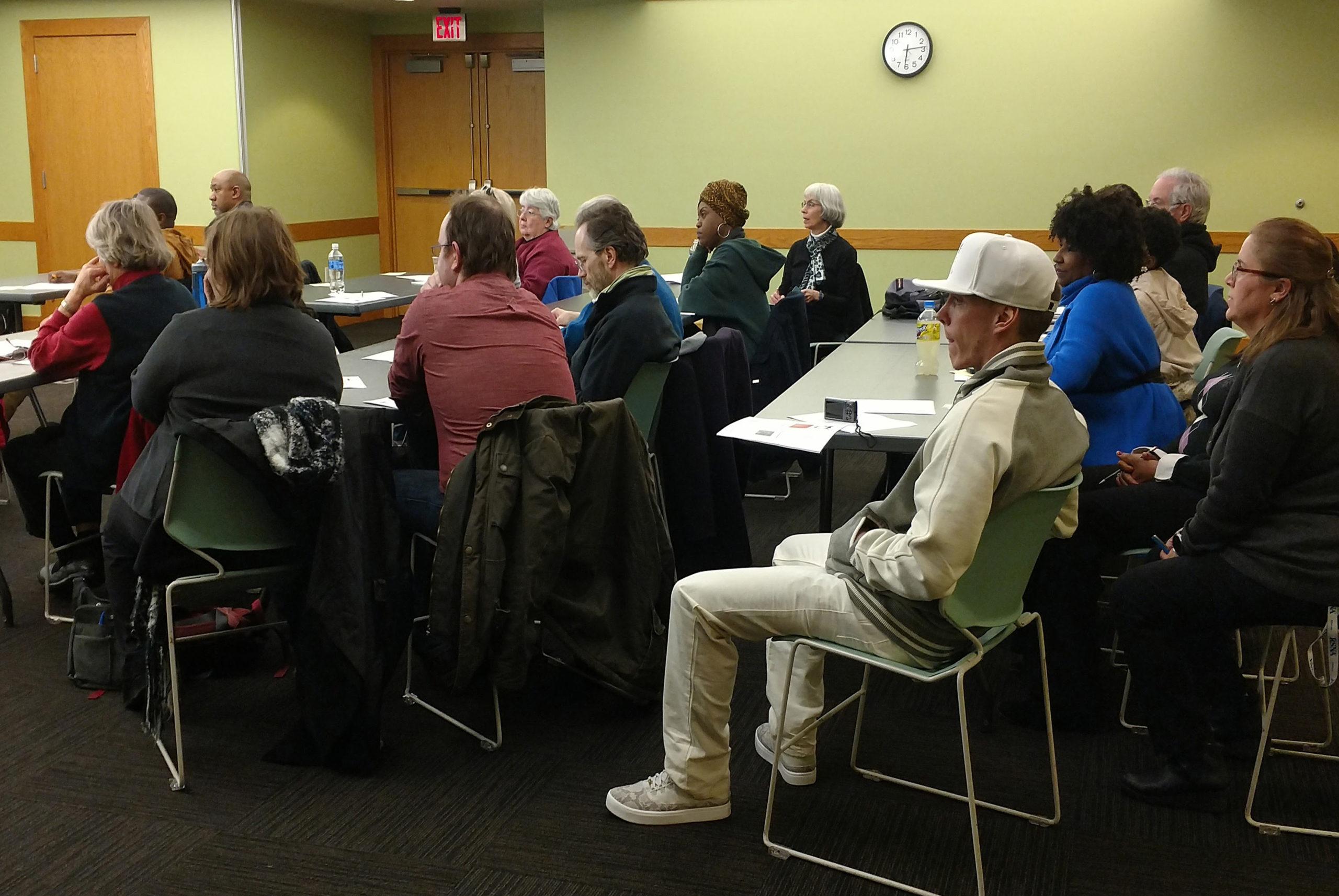 Community members attending a meeting