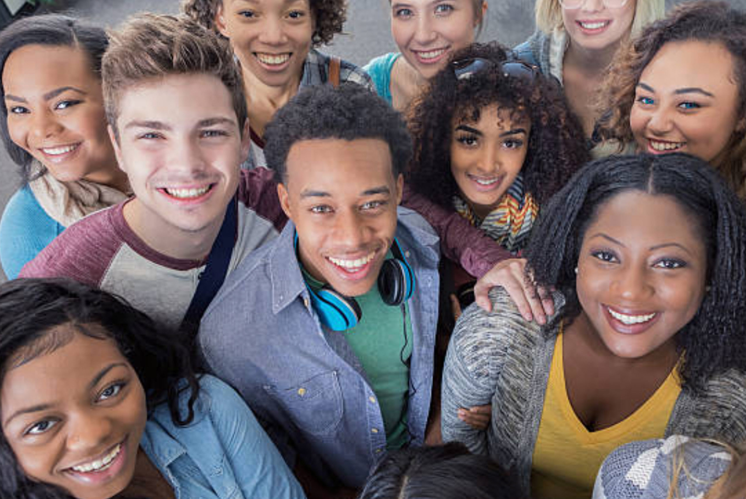 Group of young people looking up at camera
